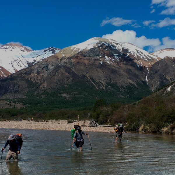 El Desagüe river wading during our Hut to Hut Trekking journey.